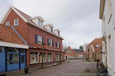 Op unieke locatie in oud Borne gelegen bedrijfspand foto 3